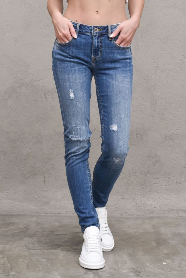 Women's jeans trousers with abrasions blue. HELENA CADENIM