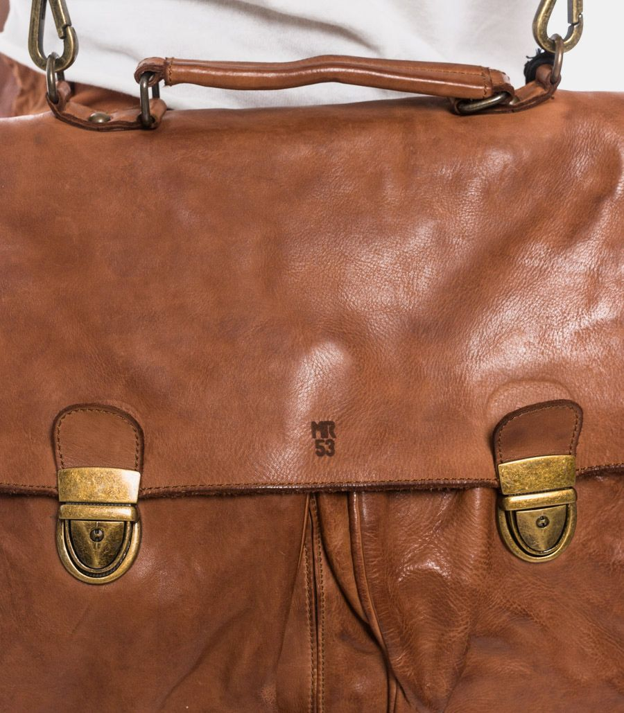 Handcrafted clip leather bag cognac